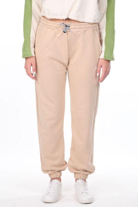 Бежевые эластичные женские спортивные штаны с вышивкой ангела