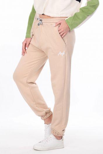 MARKAPIA WOMAN - Бежевые эластичные женские спортивные штаны с вышивкой ангела (1)