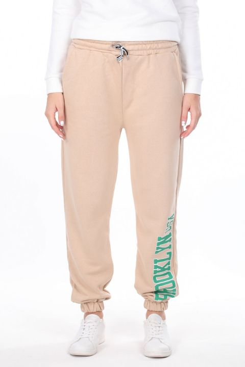Эластичные бежевые женские брюки с принтом Brooklyn