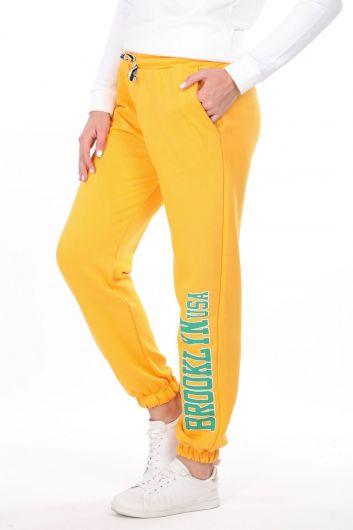 MARKAPIA WOMAN - Эластичные желтые женские спортивные штаны с принтом Brooklyn (1)