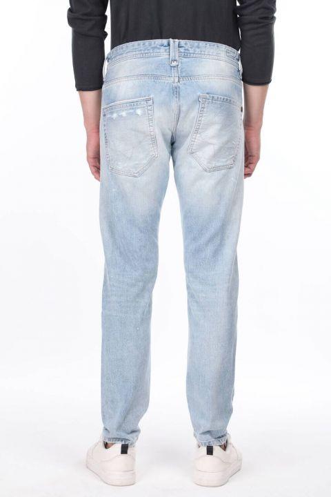 Мужские синие рваные джинсовые брюки с детализированной отделкой