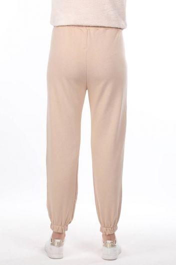 Прорезиненные женские брюки бежевого цвета с принтом Nasa - Thumbnail