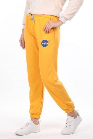 MARKAPIA WOMAN - Прорезиненные желтые женские спортивные штаны с принтом Nasa (1)