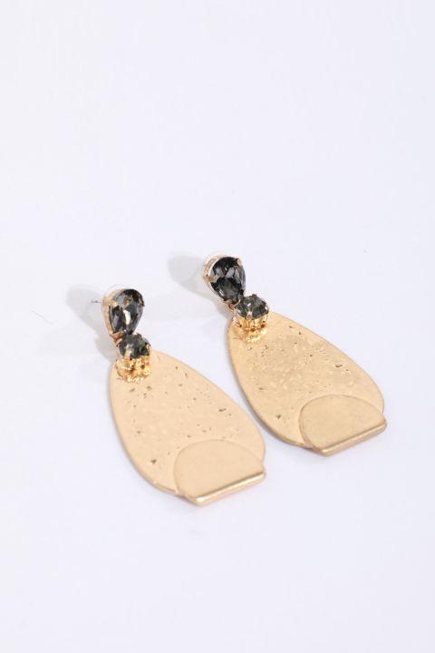 Женские овальные серьги с золотыми камнями и деталями