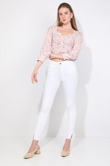 Женские белые джинсы скинни с разрезом - Thumbnail