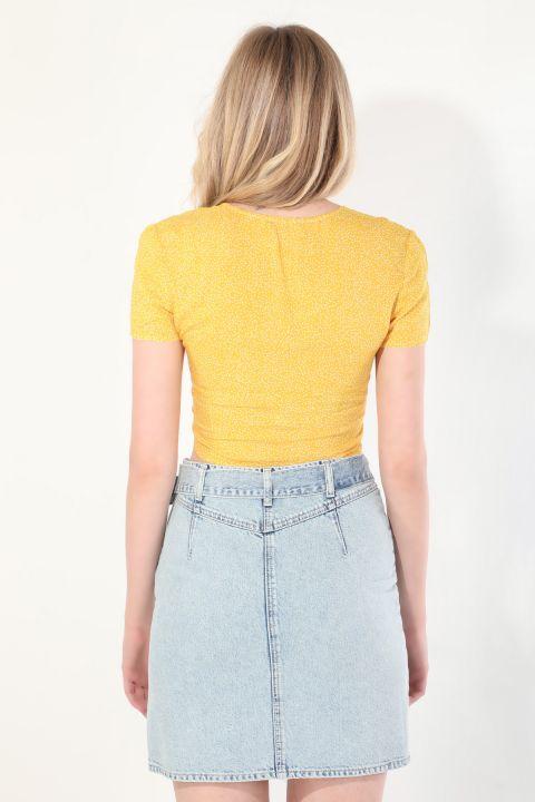 Женская желтая блуза с завязками в горошек